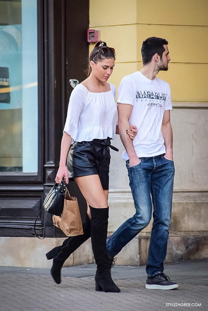 što djevojke odijevaju za večernji izlazak, street style Zagreb ulična moda, čizme preko koljena kožni šorc bijela bluza s volanima