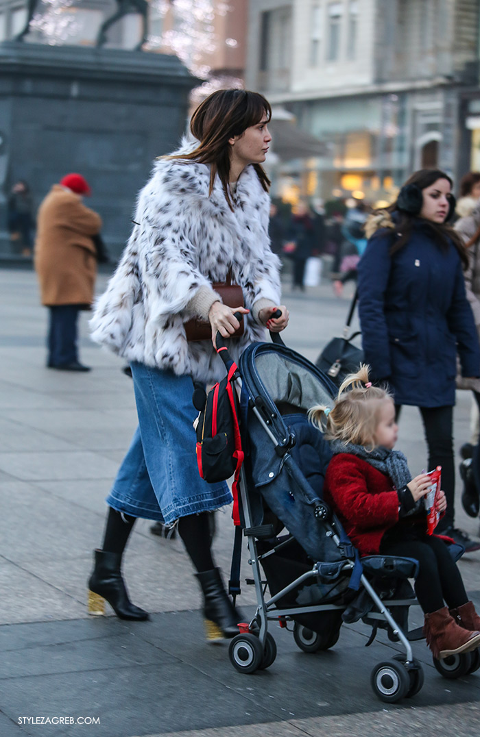 women's winter fashion what to wear street style how to wear white fur coat and denim culottes with ankle boots with block heel, stylish mother with a baby girl