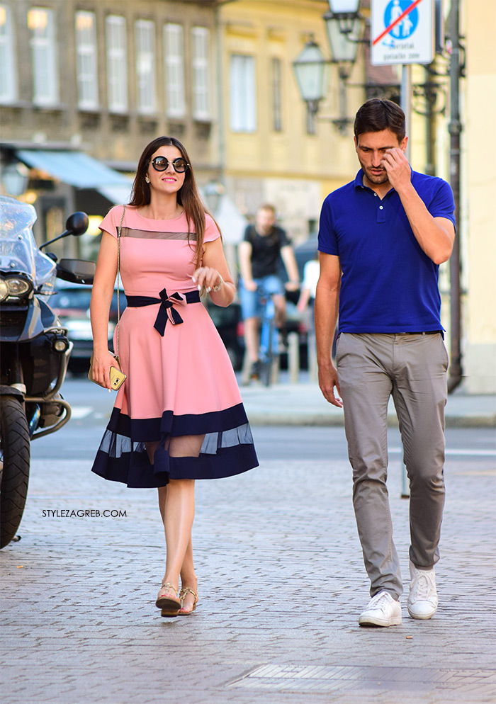 street style zagreb ljeto moda par zgodna cura u roza haljini s crnom mašnom mušakrac moda plava polo majica bijele tenisice